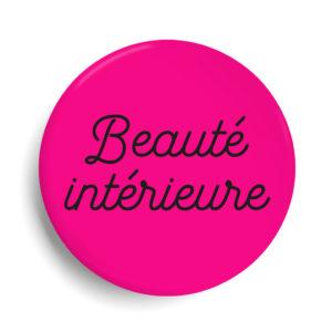 Badge beauté intérieure rose fluo